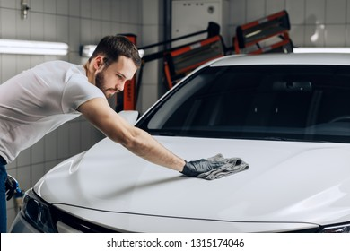 mechanic spending time in the car wash center, close up photo, gorgeous man washing the vehicle, Do you want that your car looks always great, welcome to our wash car center