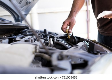 Mechanic, technician man close up hands check the car engine. car service, repair, fixing, checking maintenance working at workshop.  inspection vehicle concept.