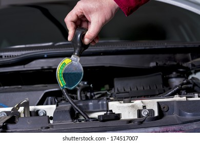 Mechanic tests the Antifreeze for winter and summer