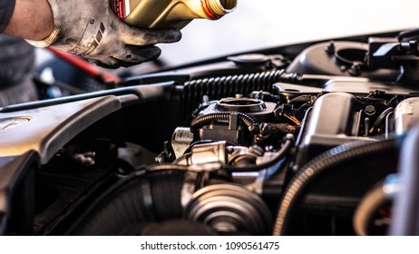 Mechanic will fill up the engine with engine oil