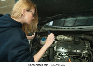 Mechanic woman working on car