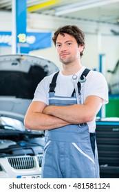 Mechanic working in car workshop