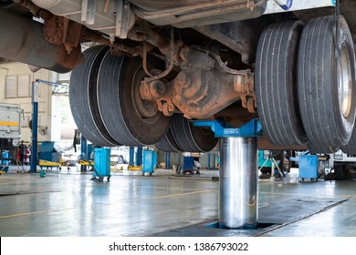 mechanic works with rear axle reduction gear of truck maintenance shop service station - Truck Service Technician Job.