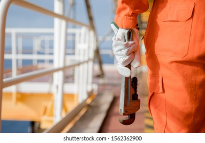 Mechanic with wrench standing on oil and gas process