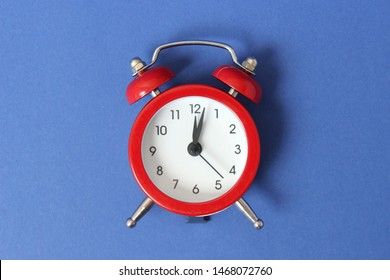 mechanical alarm clock on a colored background