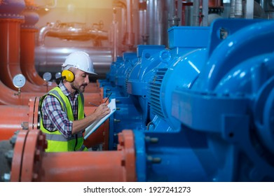 Mechanical engineer Checking of centrifugal pump in pump room. worker working in plant room.