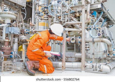Mechanical engineer checking and inspect lube oil system of centrifugal gas compressor to monitor abnormal condition of system, offshore maintenance services.