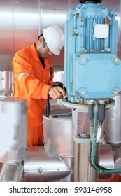 Mechanical engineer measurement of centrifugal pump vibration and electric motor at offshore oil and gas central processing platform, Oil and gas exploration and production in the gulf of Thailand.