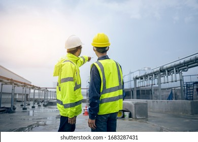 Mechanical engineer working install chilled water pipe system. Engineer consult discussion with team work for install pipe.