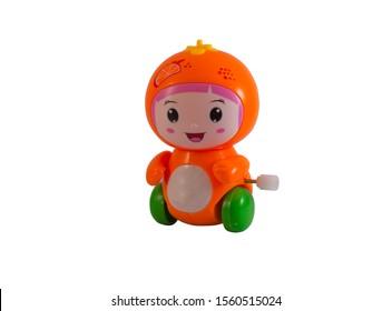 Mechanical fruits toy. Clockwork plastic toy isolated on white background.