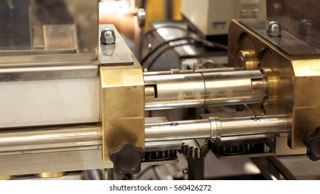 Mechanical machine equipment with rotating gear and moving parts. Automated robotic line at factory or plant.