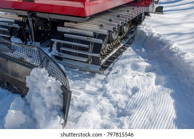 mechanical means crawler to beat the ski slope