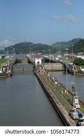Mechanical mules on rails used to guide and pull ships through the Panama Canal