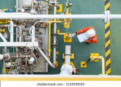 Mechanical operator checking centrifugal pump condition for daily checking oil pump system to maintain reliability of oil and gas production process.