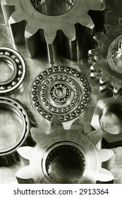 mechanical parts, gears, bearings in an old style of metallic bronze