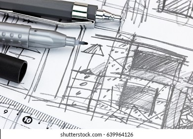 mechanical pencils and ruler on designers draft sketch of living room macro view