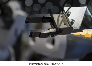The mechanical robotic  with blur blackground arm ;Selective Focus
