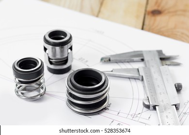Mechanical Seals for prevent liquid leak for the industry with drawings on table working.