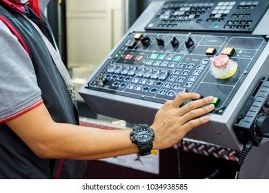 Mechanical technician operating program on control panel of high precision CNC machining center, machining die metal mold process in factory