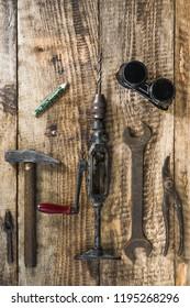 mechanical tools lying on wood planks