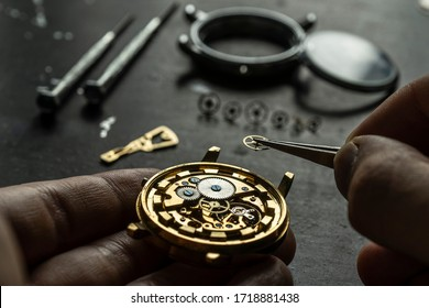 Mechanical watch repair. Watchmaker is repairing the mechanical watches