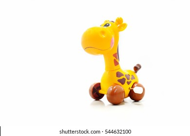 Mechanical wind up giraffe toy. Clockwork plastic toy isolated on white background.