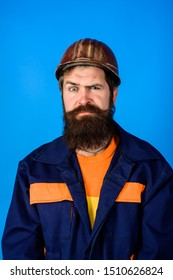Mechanical worker. Bearded man in suit with construction helmet. Portrait of handsome engineer. Construction worker in hardhat. Business, industry, technology - builder concept. Builder in hard hat.