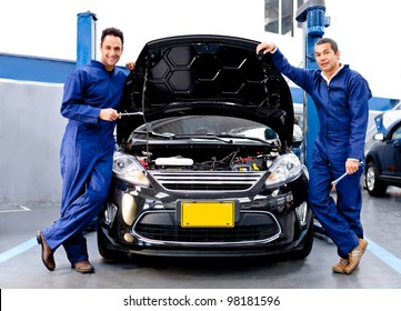Mechanics at a car repair shop fixing an engine