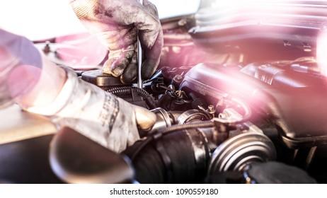 Mechanics is repairing the engine