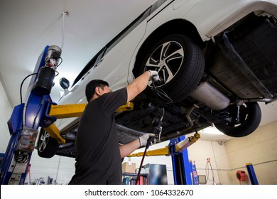 mechanics working on a car in garage