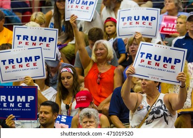 Mechanicsburg, PA  August 1, 2016: Supporters of Presidential candidate Donald J. Trump enthusiastically wave signs at a political rally in Pennsylvania.