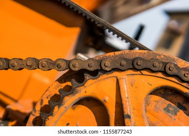 The mechanism of the chain transmission on a orange tracktor.
