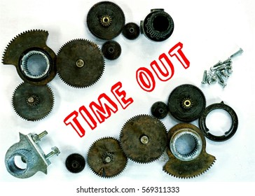 mechanism concept. gear mechanism which is arranged on a white background and the written word (time out) in the middle