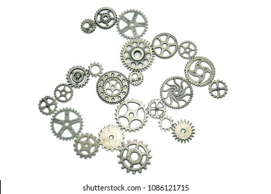 Mechanism of gears on a white background, put the pieces of the puzzle. Business concept idea, teamwork. cooperation, innovation, strategy