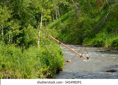 The mechanism of lifting of water with the Archimedes screw on the river in the Mountain Altai