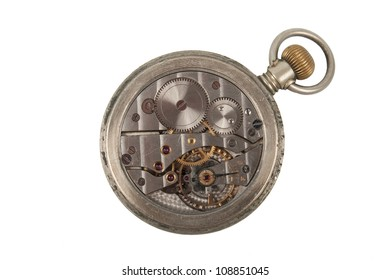 The mechanism of an old pocket watch isolated on a white background