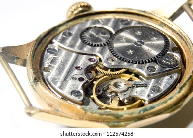 The mechanism of old watches on white background