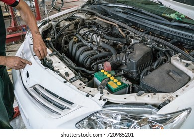 Mechatronic checked the engine compartment of a car in the garage. car engine under hood.
