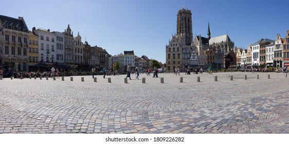 Mechelen, Antwerp/Belgium - 06 06 2015: Main square (Grote markt) of Mechelen in summertime with several guild houses and the 'St. Rumbold's Cathedral' in the background