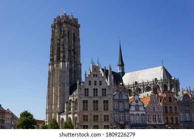 Mechelen, Antwerp/Belgium - 06 06 2015: The 'St. Rumbold's Cathedral' in Mechelen with traditional guild houses on the main square (Grote Markt)