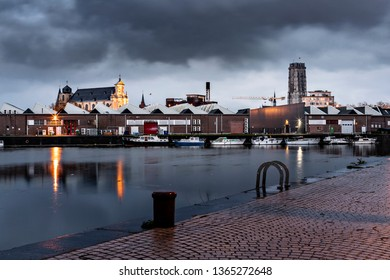 Mechelen, Belgium - April 2, 2019:  The Towesr of Saint-Rombuld's Cathedral and the Beguinage Church at blue hour