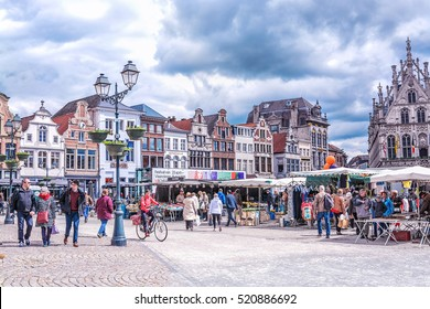 MECHELEN, BELGIUM - APRIL 22, 2016: View of historic houses and street retro cafe on Grote Markt in Mechelen (Malines), Belgium.