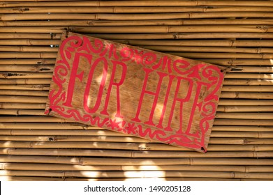 Mechelen, Belgium - August 25, 2019 - For hire sign on an asian style booth/shop
