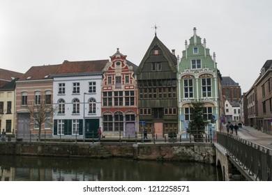 MECHELEN, BELGIUM - CIRCA JANUARY 2018: Unidentified people walk across the bridge by the historic Haverwerf buildings