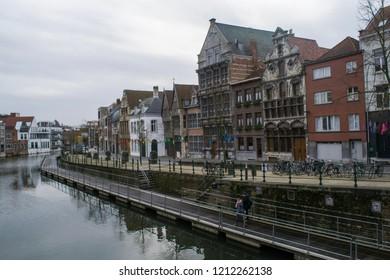 MECHELEN, BELGIUM - CIRCA JANUARY 2018: Unidentified people walk the Dijlepad riverside board walk