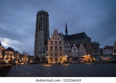 MECHELEN, BELGIUM - CIRCA JANUARY 2018: Unidentified people walk through the Grote Markt on a winter evening