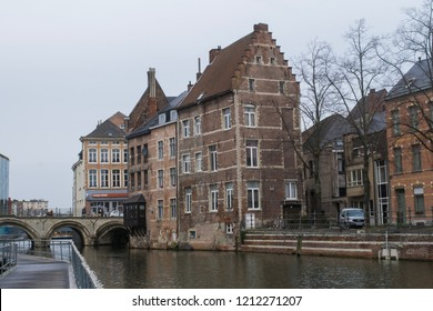 MECHELEN, BELGIUM - CIRCA JANUARY 2018: Unidentified people walk by historic buildings along the Dilje River