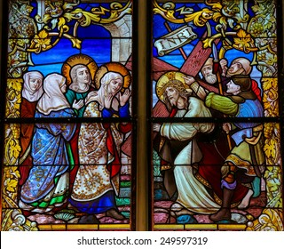 MECHELEN, BELGIUM - JANUARY 31, 2015: Stained Glass window depicting Jesus and Mary on the Via Dolorosa, in the Cathedral of Saint Rumboldt in Mechelen, Belgium.