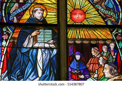 MECHELEN, BELGIUM - JANUARY 31, 2015: Stained Glass window depicting Saint Thomas Aquinas (1225 - 1274), Italian Dominican friar, with Cardinal Mercier, in the Cathedral of Mechelen, Belgium.