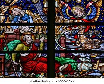 MECHELEN, BELGIUM - JANUARY 31, 2015: Stained Glass window depicting the Dream of Saint Joseph, in the Cathedral of Saint Rumboldt in Mechelen, Belgium.